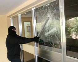 Security film stopping man gaining entery through glass
